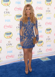 Kimberly Perry went the ultra-feminine route in a Lorena Sarbu sheer-illusion cocktail dress with blue embroidery during the Teen Choice Awards.