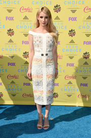 For her footwear, Emma Roberts chose simple yet still-on-trend Stuart Weitzman Nudist sandals, in white.
