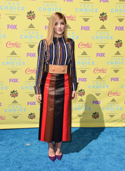 Willow Shields wore a vibrant mix of stripes with this Marni leather skirt and blouse ensemble.