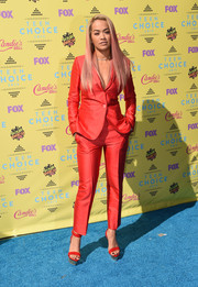 Rita Ora matched her suit with red Versace platform sandals.