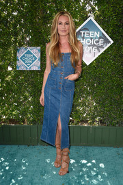 Cat Deeley styled her dress with elegant tan lace-up heels.