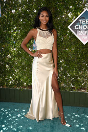 A flowing satin skirt with a high side slit completed Chanel Iman's outfit.