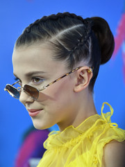 Millie Bobby Brown styled her hair into a bun with a braided top and sides for the 2017 Teen Choice Awards.