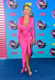 Rita Ora polished off her chic ensemble with silver ankle-strap sandals by Jimmy Choo.