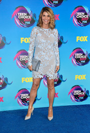 Lori Loughlin was sexy and ladylike at one in this pastel-blue lace mini dress at the 2017 Teen Choice Awards.