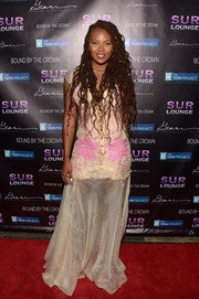 Eva Marcille donned a nude button-front maxi dress with pink embroidery for the Teen Dream event.