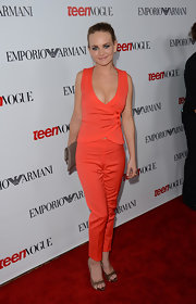 Britt Robertson proved that a pantsuit could be super sexy with this bright orange number.