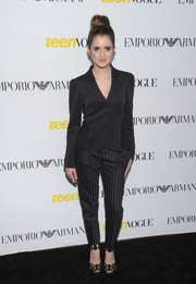 Laura Marano complemented her jacket with a pair of black-and-white striped pants, also by Emporio Armani.