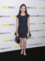 Mackenzie Foy attended the Teen Vogue Young Hollywood Issue party wearing a navy jacquard mini dress.