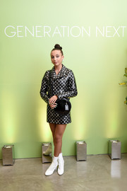 Emma Chamberlain attended the Generation Next event rocking a Louis Vuitton monogram skirt suit.