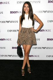 Madison Beer infused some animal appeal into her cute ensemble with a leopard-print mini skirt when she attended the Teen Vogue Young Hollywood party.