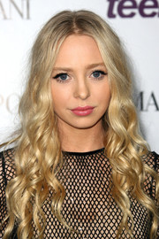 Portia Doubleday looked just like a doll with her long blond wavy hair at the Teen Vogue Young Hollywood party.
