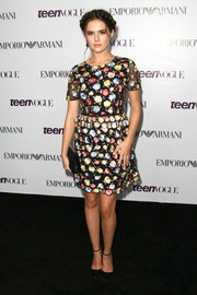 Zoey Deutch charmed in a colorful floral cocktail dress at the Teen Vogue Young Hollywood party.