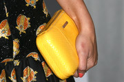 Alyson Michalka brightened up her look with this yellow hard-case clutch when she attended the Teen Vogue Young Hollywood party.