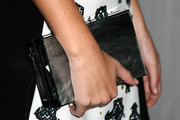 Olivia Holt completed her ensemble with a sophisticated gray box clutch when she attended the Teen Vogue Young Hollywood party.