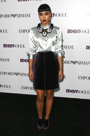 Natalia Kills attended the Teen Vogue Young Hollywood party sporting a purple velvet skirt and silk button-down combo.
