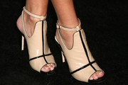 Olivia Holt wore a mod pair of nude and black cutout boots to the Teen Vogue Young Hollywood party.