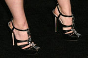 Kaitlyn Dever went to the Teen Vogue Young Hollywood party wearing an ultra-glam pair of bejeweled black strappy pumps.