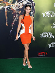 Megan Fox turned up the heat in an orange and white cutout mini by Cushnie et Ochs at the Sydney premiere of 'Teenage Mutant Ninja Turtles.'