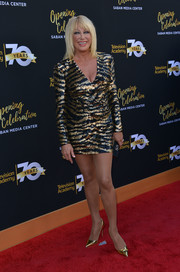 Suzanne Somers flaunted her gorgeous pins in a black and gold zebra-patterned sequin dress at the Television Academy's 70th anniversary gala.