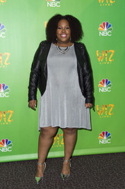 A black leather jacket with studded shoulders toughened up Amber Riley's look.