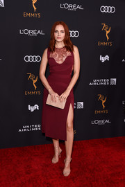Madeline Brewer teamed her frock with strappy nude heels by Brian Atwood.