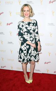 Sarah Paulson went the demure route in this long-sleeve floral frock during the cocktail reception celebrating the 67th Emmys.