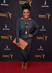 For her bag, Yvette Nicole Brown picked a woven orange clutch.