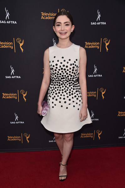Emily Robinson cut a sweet figure in a sleeveless white fit-and-flare dress with black floral beading during the Television Academy and SAG-AFTRA Dynamic and Diverse celebration.