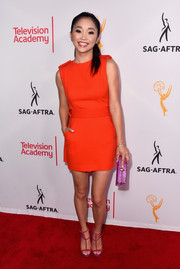 Lana Condor styled her frock with a pair of red and purple gladiator heels.