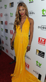 Laverne Cox totally glammed it up in a draped yellow velvet gown by Marc Bouwer at the Television Industry Advocacy Awards.