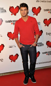 Maxi looks dashing in this casual red v-neck sweater.