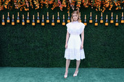 Kate Mara finished off her look with white and silver slingback peep-toes by Christian Louboutin.