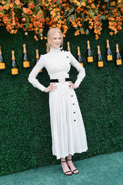 Nicole Kidman went for simple styling with a pair of black ankle-strap sandals by Stuart Weitzman.