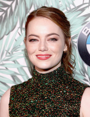 Emma Stone kept it relaxed yet chic with this loose, wavy ponytail at the Women in Film pre-Oscar cocktail party.