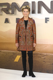 Linda Hamilton styled her look with black over-the-knee boots.