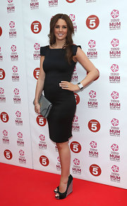 Danielle Lloyd opted for a more modern version of the LBD with this fitted dress with square sleeves.