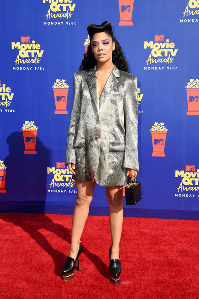 Tessa Thompson Leather Purse [movie,red carpet,carpet,clothing,flooring,premiere,fashion,electric blue,footwear,outerwear,event,tessa thompson,tv awards,barker hangar,santa monica,california,mtv]