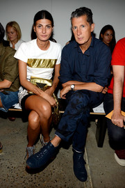 Giovanna Battaglia was sporty-chic in a white and gold T-shirt during the Thakoon fashion show.