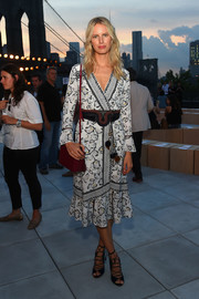 Karolina Kurkova injected some color with a boxy red shoulder bag.
