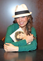 Thalia kept it casual and classy in her white panama hat while signing copies of 'Growing Stronger.'