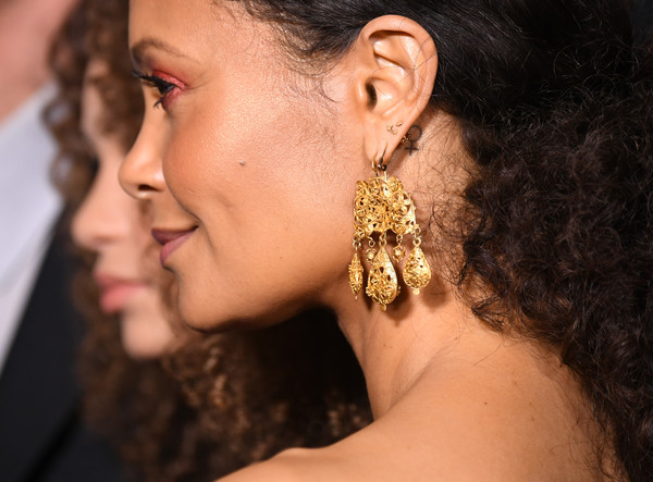 Thandie Newton Gold Chandelier Earrings [hair,face,ear,nose,chin,earrings,hairstyle,beauty,neck,skin,arrivals,nico parker,thandie newton,dumbo,california,los angeles,el capitan theatre,disney,premiere,premiere]