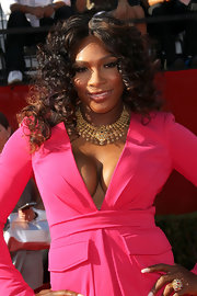 Serena Williams attended the 2011 ESPY Awards wearing an ornate gold statement necklace.
