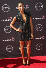 Gabrielle rocked the edgy look at the ESPY Awards where she wore this V-neck mini dress with silver embellishments.