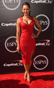 Melanie Brown sizzled in a low-cut, curve-hugging red dress during the ESPYs.