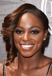 Sloane Stephens was elegantly coiffed with side-swept curls at the 2015 ESPYs.