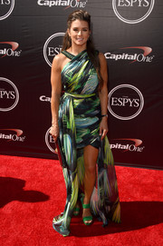 Danica Patrick sealed off her vibrant red carpet look with a pair of green strappy sandals.