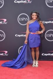 Simone Biles chose a royal-blue one-shoulder mini dress with a floor-sweeping side train for her 2017 ESPYs look.