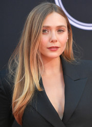 Elizabeth Olsen opted for a casual center-parted hairstyle when she attended the 2017 ESPYs.