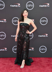Mirai Nagasu polished off her look with silver ankle-strap sandals by Sam Edelman.